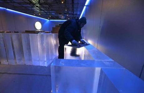 Adam Steffler of Iceculture trimmed 300-pound blocks of ice.